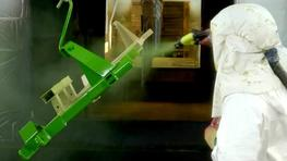 Spraying of final coat on large parts